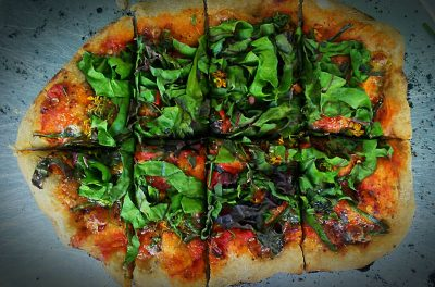 brick oven pizza with greens