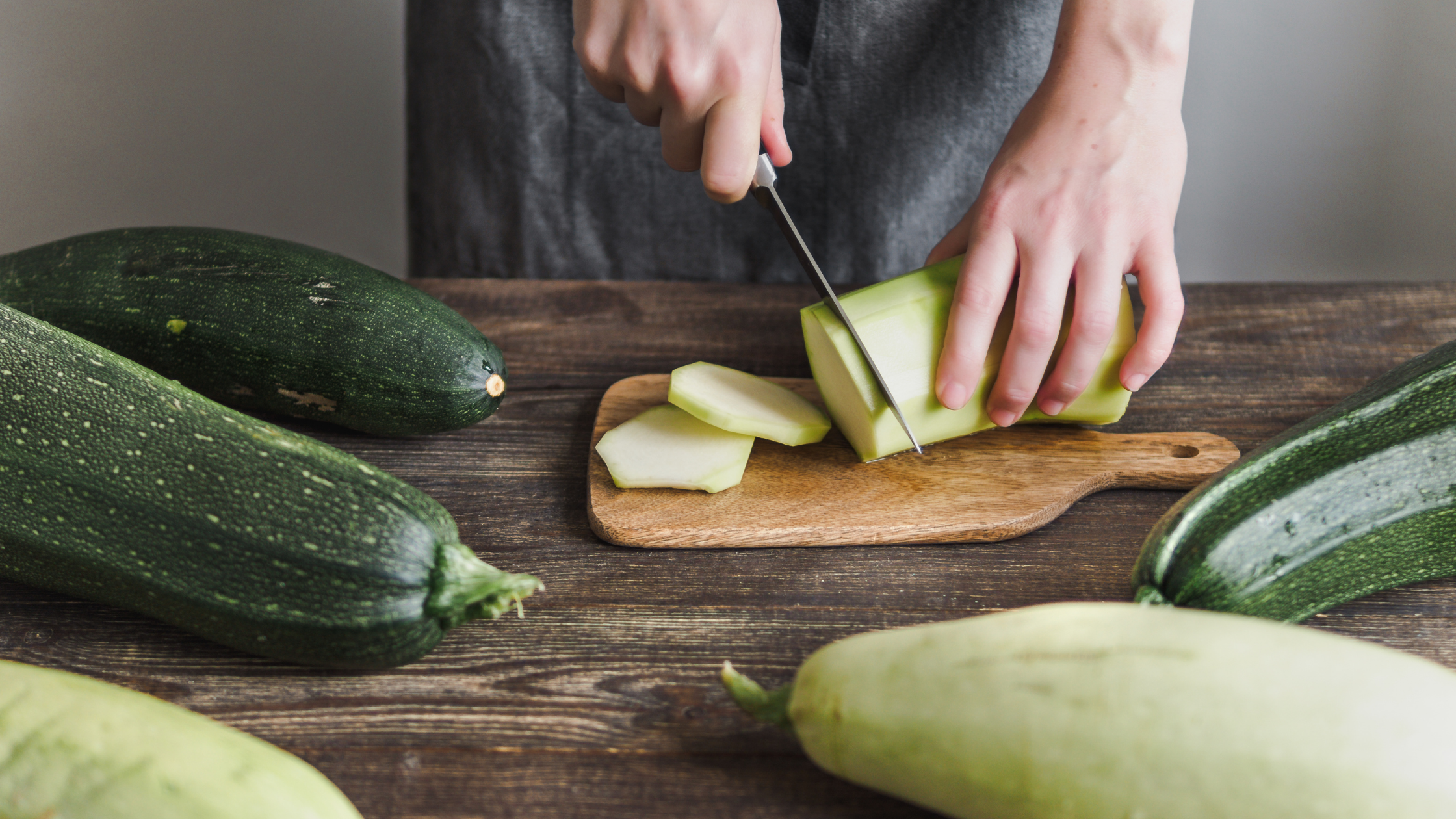 female slicing varieties of zucchini on a cutting board